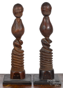 Pair of carved figural posts, early/mid 20th c.