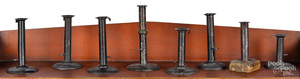 Eight hogscraper candlesticks, 19th c.