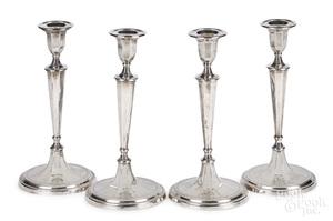 Set of four English Sheffield silver candlesticks