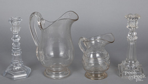 Two colorless glass pitchers