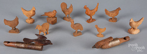 Group of carved animals, bird whistles, etc.