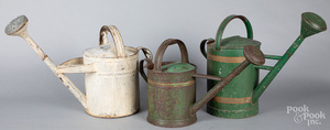 Three painted tin watering cans