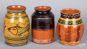Three Shooner redware jars