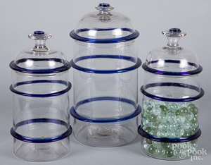 Three clear and cobalt glass apothecary jars