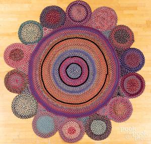 Unusual round room size braided rug