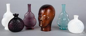 Colored glass bottle, together with a wig stand