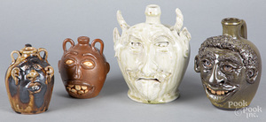 Four southern pottery face jugs