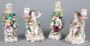 Two pairs of porcelain figural candlesticks