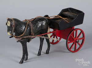Carved and painted wood horse drawn wagon