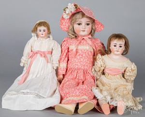 Three bisque dolls