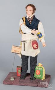 Composition gentleman peddler doll, 20th c.