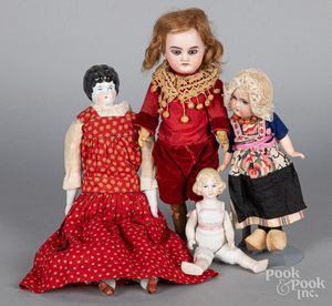 Four small bisque head dolls