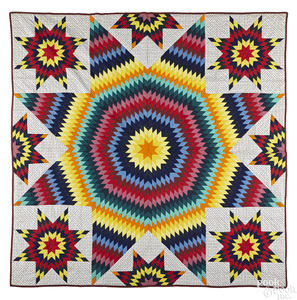 Colorful Pennsylvania pieced rising sun quilt