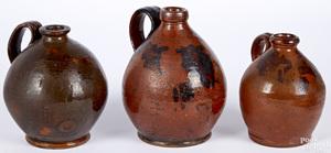 Three redware ovoid jugs