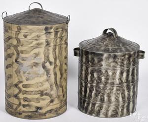 Two smoke decorated tin bins