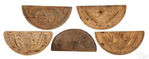 Five carved demilune butterprints