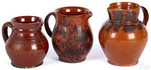 Three Pennsylvania redware pitchers