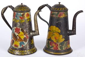 Two black toleware coffee pots