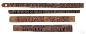 Four carved bag stamps