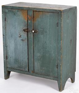 New England diminutive painted butternut cupboard