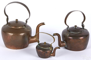 Three small copper kettles