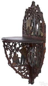Elaborate painted and cutout mahogany shelf