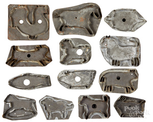 Collection of thirteen tin cookie cutters