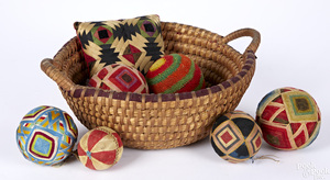 Seven Pennsylvania sewing balls and basket