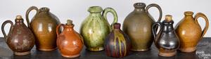 Eight miniature redware ovoid jugs