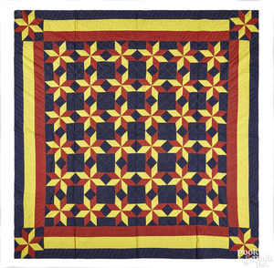 Vibrant pieced star pattern quilt