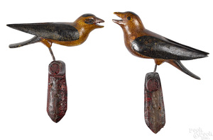 Pair of carved and painted song birds on perches