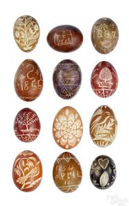 Twelve Pennsylvania pin carved chicken eggs