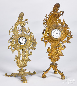 Two similar brass watch hutches