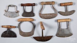 Eight early iron and wood food choppers.
