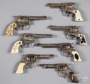 Seven toy cap guns