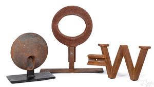 Three cast iron windmill weights