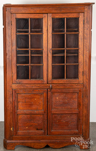 Pine one-piece corner cupboard, early 19th c.