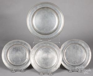 Four pewter plates