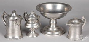 Three pewter syrup pitchers