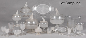Large collection of colorless glass stemware.