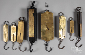 Eight early brass and iron scales.