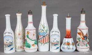 Seven milk glass barber bottles
