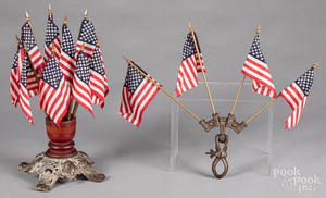 Two wood and metal American flag display stands