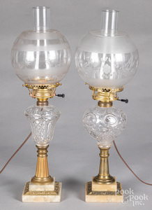 Two glass fluid lamps, with etched shades.