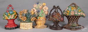 Five cast iron floral doorstops