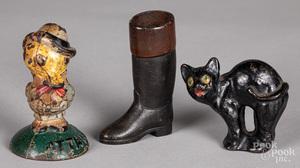 Three cast iron paperweights