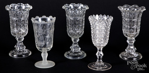 Five colorless glass vases