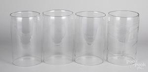 Four blown glass hurricane shades