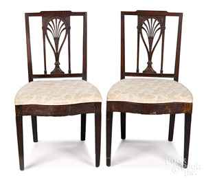 Pair of carved mahogany racquetback dining chairs