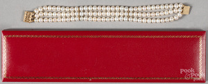 Three strand pearl bracelet with 14K gold clasp